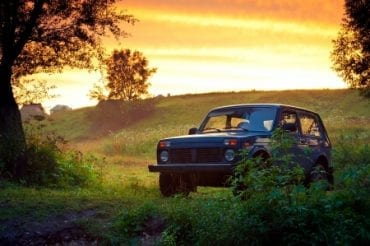 18769201 - soviet and russian suv lada niva 4x4 on sunset